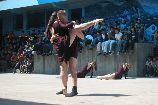 Helen Hatch and Scott Willits performing in a public school in Zunil, Guatemala